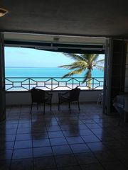 Luquillo condo photo - The Living Room Opens Up To The Ocean Front Balcony.