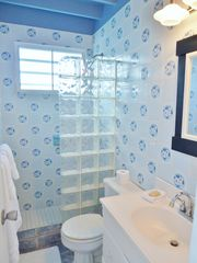 Vieques Island cottage photo - The downstairs bath is cheery and bright.