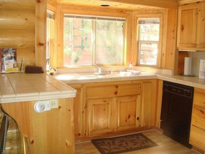 Wake up to the smell of coffee brewing in this bright pine kitchen.