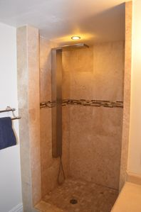 Master bath shower panel featuring rain cascade shower and multi port massage