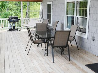 Burt Lake cabin photo - Covered Deck With New Patio Set, Porch Swing & BBQ all for your private use...