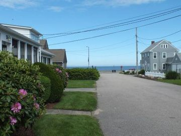 Narragansett cottage rental - View from front yard down to Seawall.
