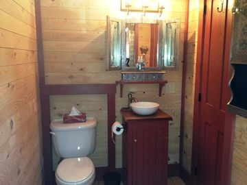 1/2 Bath Just Off Mudroom Entryway with Vessel Sink- Also A Place To Store Gear