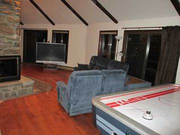 Great room extends to include game area (7' air hockey table)