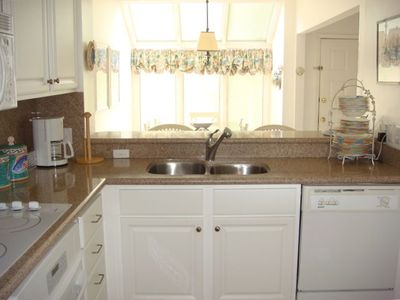 The kitchen countertops and appliances are renovated with a granite theme.