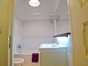Social bathroom - with bathtub and showerhead