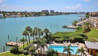 ENJOY A FABULOUS INTRACOASTAL VIEW IN THIS 2 BR UPSCALE PALMS OF TREASURE ISLAND CONDO!