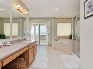 St. Augustine cottage photo - Our luxury master bathroom with shower, tub & 2 vanities