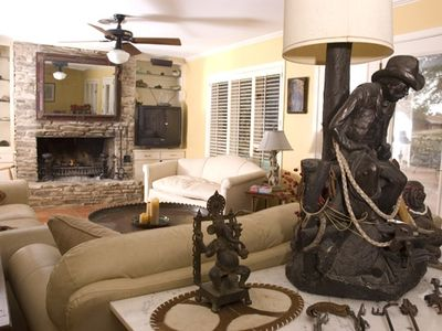 Large stone fireplace highlights one of two living rooms.
