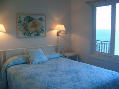 The guest bedroom has a queen size bed with the Pacific ocean just outside.