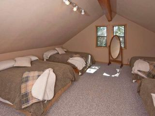 Tahoe Donner cabin photo - Third floor loft (4th bedroom). 4 full beds and a small couch, plus 27 inch tv