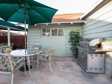 Enjoy Dining and Grilling in the Back Yard