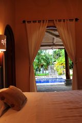 Playa Hermosa house photo - Guest bedroom with pool view from bed