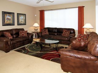 Windwood Bay villa photo - Family room with warm leather seating and 56 inch flat screen TV