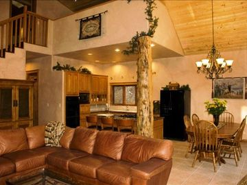 Big Bear City cabin rental - Spacious livingroom, kitchen and dining area - seating for 10 at the table.