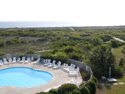 View from deck of pool, ocean and boardwalk to beach.