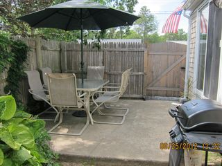 Dennisport cottage photo - Private patio. Slider leads into the dining area.