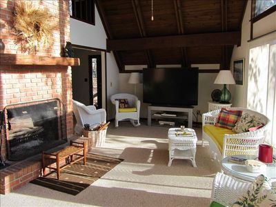 Open living area w/ Big Screen tv and wood burning fireplace.