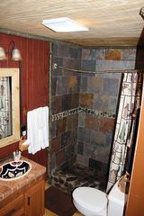 Blairsville cabin photo - Bathroom shower made from stones