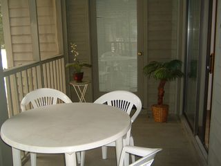 Pawleys Island condo photo - Screened porch with door to master bedroom