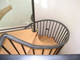 Taos house photo - The handmase imported Italian spiral staircase up to the office, loft and study