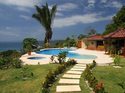 The pool area of Villa de Amor