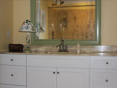 Master bath has marble jetted whirlpool tub