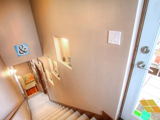 Seattle townhome photo - Stairs leading from kitchen to master suite to roof deck filled with amazing art