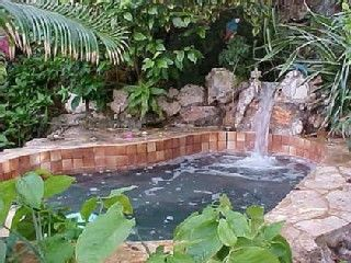 Jacuzzi with waterfall in garden