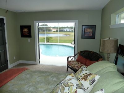 Walk out to the pool from the master bedroom or enjoy coffee in bed with a view!