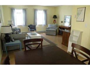 York Beach condo photo - Living room offers comfortable sitting area along with flat screen TV