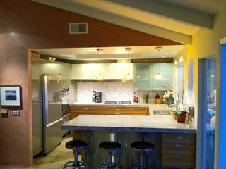 Palm Springs house photo - Modern, award-winning kitchen is fully stocked, counter seats 4.