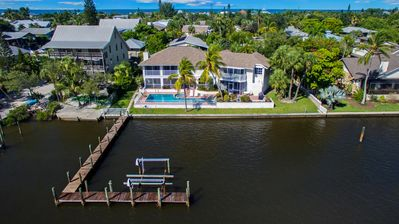 a grand bayfront home with 42ft heated pool / spa, and a private deep water pier