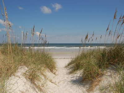 Gorgeous beaches, soft sand and beautiful dunes frame the blue ocean and sky.