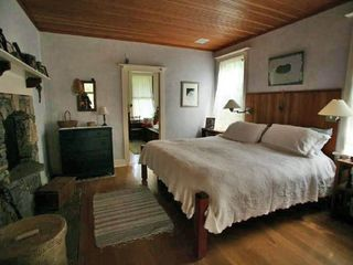 Madaket house photo - Master Bedroom with stone fireplace (on left) )Natural wood ceiling
