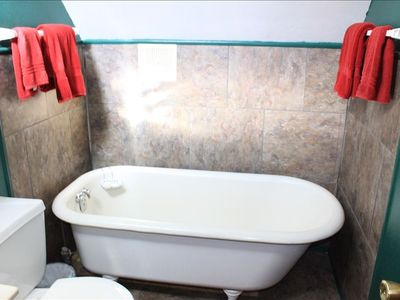enjoy a relaxing soak in the upstairs claw bathtub
