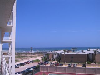 South Padre Island condo photo - Watch the beach walkers, the waves roll in or the fishermen on the beach.