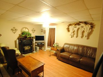 Living room on lower level with gas fireplace, flat screen TV with surround soun