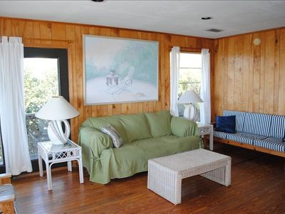 Comfortable family gathering area with view right out to the Gulf