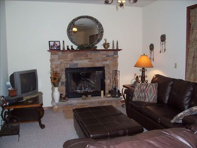 Living rm w/sofa, love seat, wood fireplace, cable