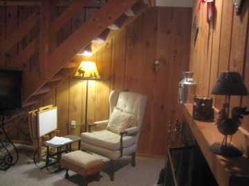 A cozy, little nook under the loft stairs.
