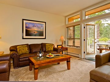 Incline Village condo rental - Welcoming living room with french doors opening to private deck and forest.