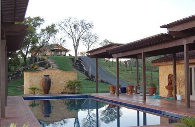 Huge pool overlooking lake 55'x18' Casita on top of hill.