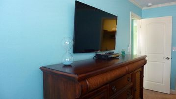 New 47' TV in master bedroom and island inspired new furniture.