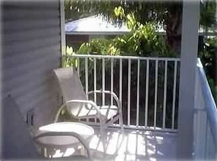 A large comfortable Lanai with a view of Crescent Beach