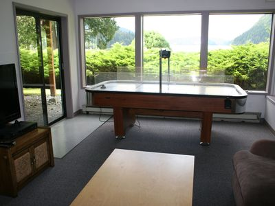 Game room with HDTV and air hockey table. Dart board and ping pong next door.