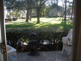 St. Simons Island condo photo - The den flows right out onto the patio which overlooks the grassy courtyard.