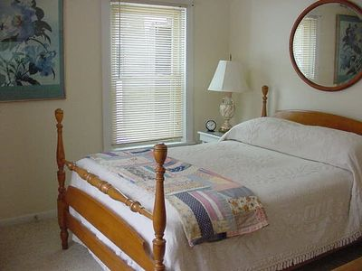 The double bed on the main floor, adjacent to the bathroom, is antique maple.