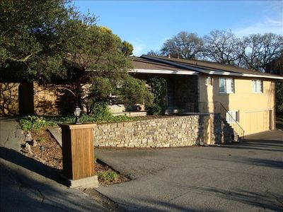 Stone and stucco exterior (2/3 stone), very large parking area w/ circular drive
