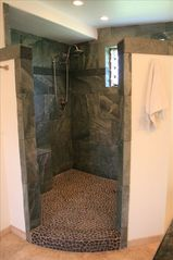 Kailua house photo - custom slate shower with 2 shower heads and 4 body